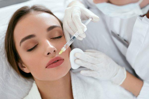 Women receiving lip injections